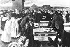 Funeral lowering the coffins cropped